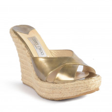 These metallic patent 'Phyllis' espadrilles wedges slides are comfortable and glamorous. These wedges feature espadrille soles and have golden, glossy patent leather crisscross straps at the toes. The leather padded insoles feature Jimmy Choo labels-2